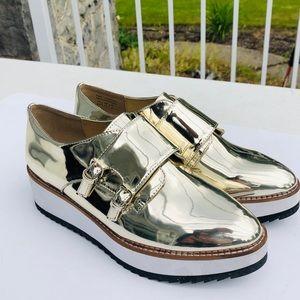 Aldo gold fancy buckle shoes size 6.5
